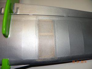 Repair in progress to underside of wing.
