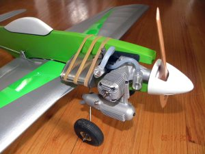 The business end of the Mustang. The fuel tank bracket still needs to be installed but the rubber bands will work for the maiden flights. Also, the fuel line from the tank to the needle valve was shortened after this photo was taken.
