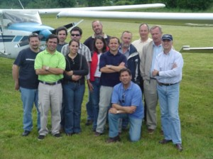 Claudio, at right wearing hat, with pilot friends