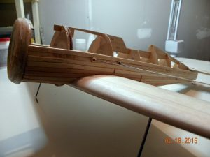 Side view of rounded edge planking strips being installed.