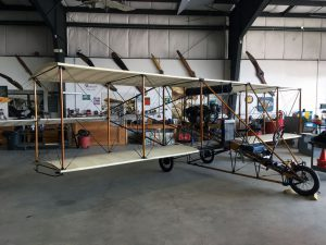 An early Curtiss biplane in the restoration workshop.
