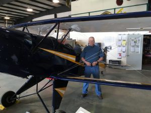 Bob Bailey, Aviation Curator, runs the Aircraft Restoration Workshop. Here he is with his own personal aircraft, a 1961 Bucker Jungmann.
