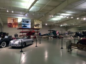 Cars, motorcycles, and planes share display space throughout the museum.