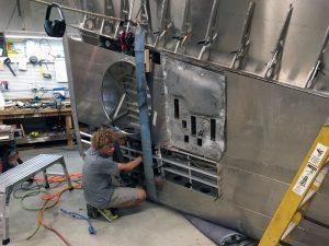 Intern working on right wing landing gear installation