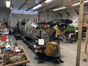P-40 restoration shop with pilot replica