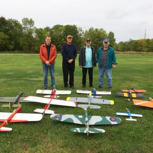 Mike O'Neill, Steve Dwyer, Chuck Smith, and George Eckhardt with their full squadron of control line planes ready to fly.